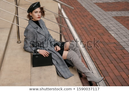long legs in leather boots over black stock photo © dolgachov