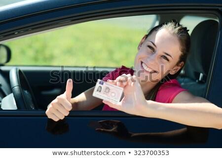 Jonge vrouw tonen nieuwe rijden frans meisje Stockfoto © photography33