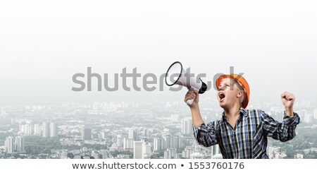 A female construction worker promoting. Stock photo © photography33