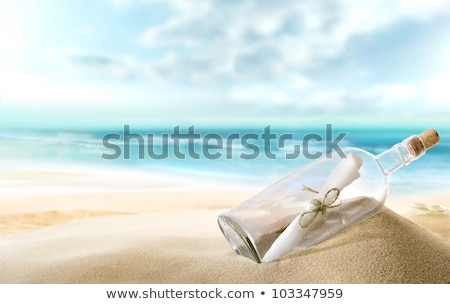 Stock photo: seashells in a bottle on the beach