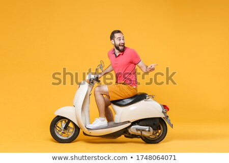 casual man sitting and pointing up stock photo © feedough
