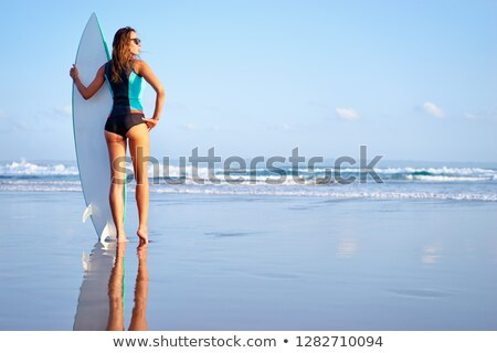 Girl holding surf board Stock photo © zzve