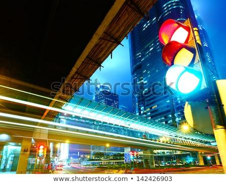 éjszaka közlekedési lámpa Bangkok Thaiföld autó út Stock fotó © Witthaya