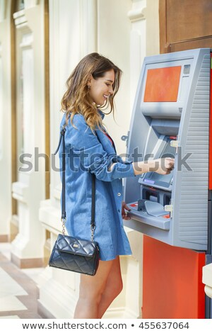 A young girl and an ATM Stock photo © RuslanOmega
