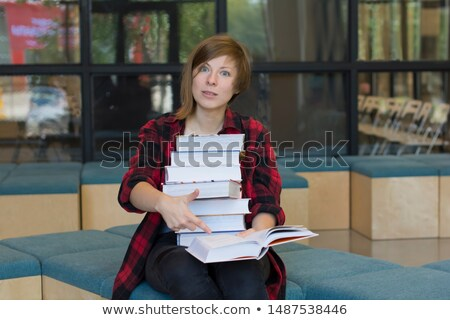 Man looking at a selection of books in shock Stock photo © photography33