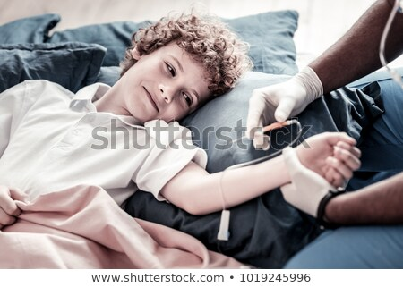 Doctor putting a drip on the arm of his patient Stock photo © wavebreak_media