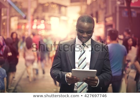 Businessman With Tablet Computer - man in city stock photo © adamr