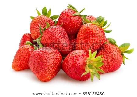 A pile of fresh strawberries isolated on white background stock photo © deymos