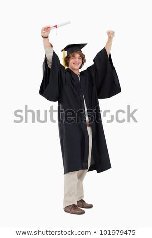 Estudante pós-graduação robe branco em pé boné Foto stock © wavebreak_media