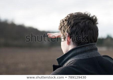 Fiatal üzletember néz messze messze kifakult Stock fotó © chesterf