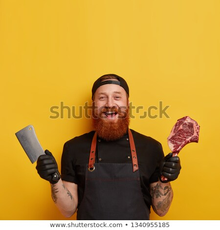 Male chef showing meat cleaver Stock photo © wavebreak_media