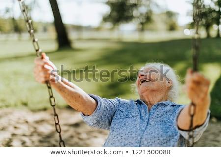 Senior woman swinging stock photo © gophoto