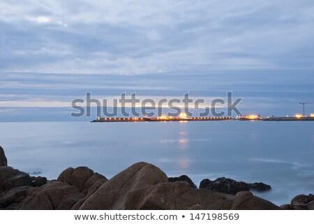 Long exposure of beach with city, Matosinhos, Portugal Stock photo © dinozzaver