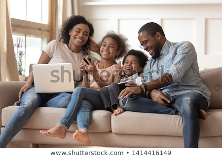 mother and kid are playing game on the phone stock photo © d13