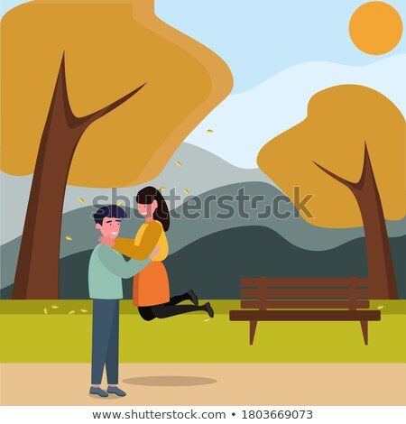 Lover boy lifts the girl in the autumn park Stock photo © Geribody