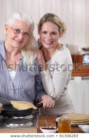 Elderly woman and daughter with pancakes Stock photo © photography33