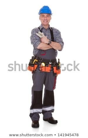 mature man holding wrench stock photo © andreypopov