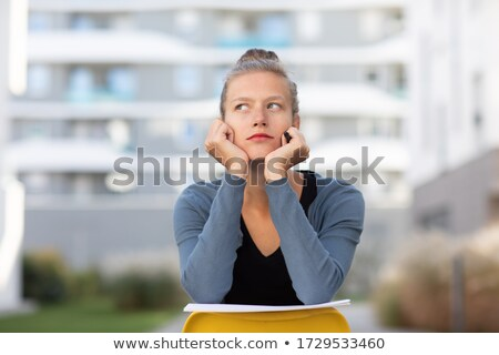 Woman in white sit backwards on chair Stock photo © vetdoctor