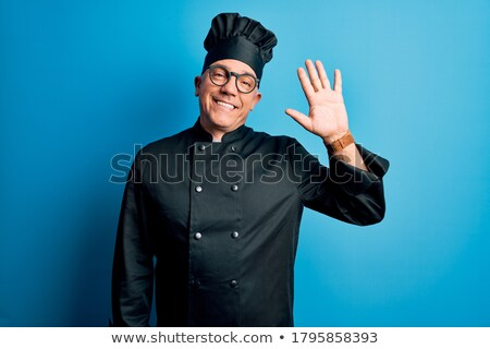 happy aged chef gesturing welcome stock photo © stockyimages
