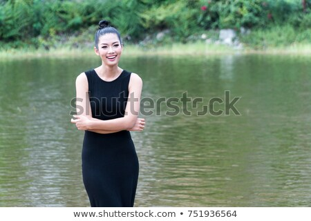 Young girl in black dress on white backgroung stock photo © fotorobs