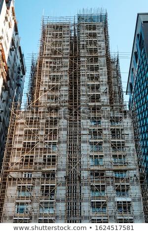 Váz felhőkarcoló épület építkezés nap naplemente Stock fotó © meinzahn