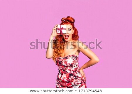 beautiful redhead pin up style girl holding gift box stock photo © elisanth