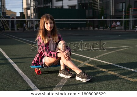 Girl sitting on a skateboard on the tennis court Stock photo © vlad_star