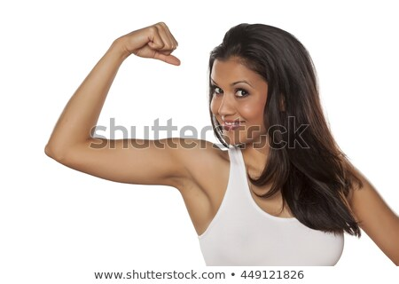 indian young woman flexing biceps stock photo © bmonteny