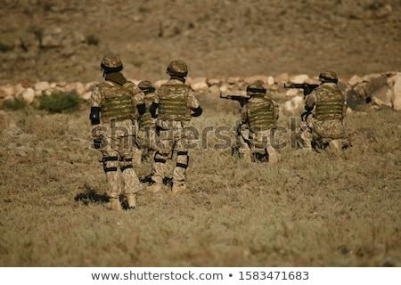 armado · homem · indicação · estúdio · pistola - foto stock © oleksandro