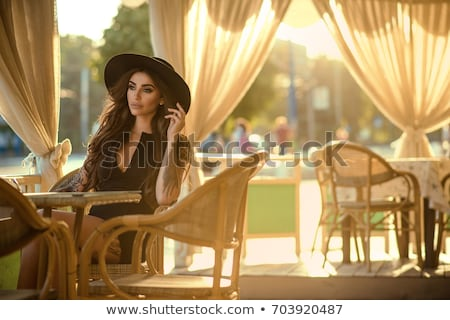 Girl sitting in chair, thoughtfully looking aside. Stock photo © kyolshin
