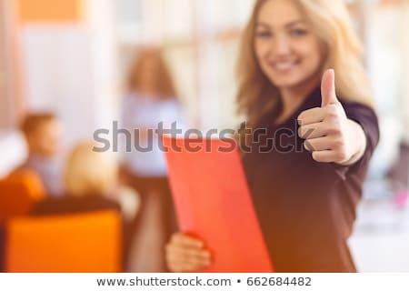 creative business team gesturing thumbs up in a meeting stock photo © wavebreak_media