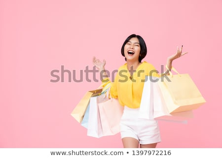 Happy Woman Raising Colored Shopping Bag Stock photo © juniart