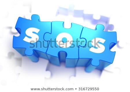 SOS - White Word on Blue Puzzles. Stock photo © tashatuvango