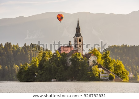 catholic church in bled lake and bled castle slovenia with hot stock photo © kayco