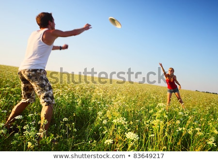 young couple playing frisbee stock photo © fotoedu
