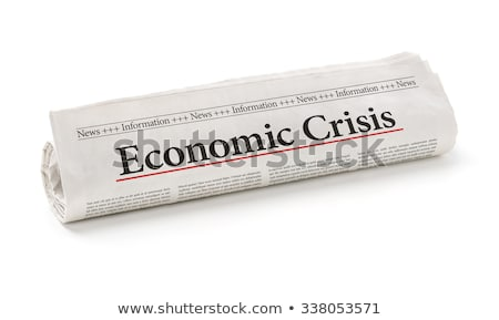 Rolled newspaper with the headline Economic Crisis Stock photo © Zerbor
