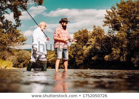 Man with fishhook Stock photo © deyangeorgiev
