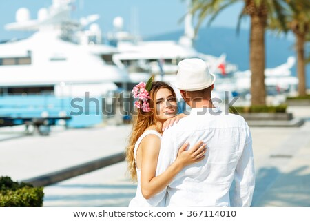 Attractive young couple walking alongside the marina in summer s Stock photo © vlad_star