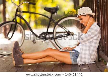 pretty young woman with a laptop at park stock photo © nobilior