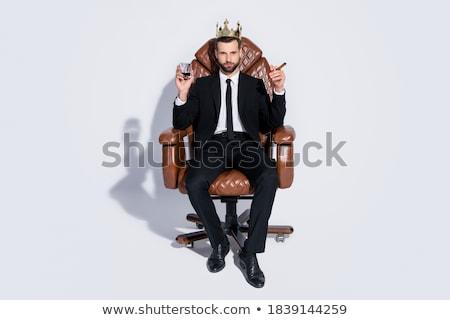 jóképű · üzletember · ül · irodai · szék · dohányzás · szivar - stock fotó © deandrobot