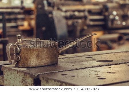 Woman with oil can. Stock photo © RAStudio