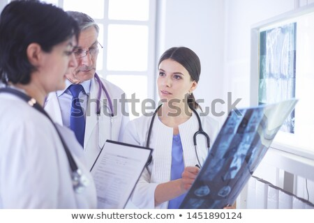 Stock photo: Female doctor checking xray image
