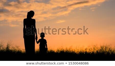 silhueta · mãe · bebê · flor · mãos · beleza - foto stock © adrenalina