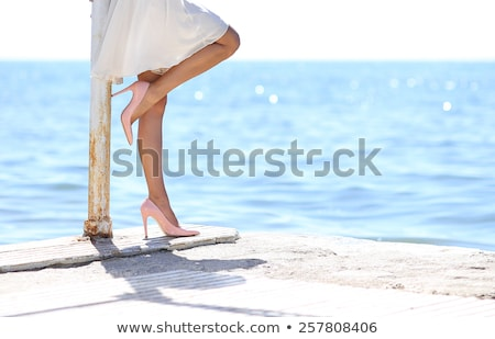 Stock photo: Woman in white dress at seaside