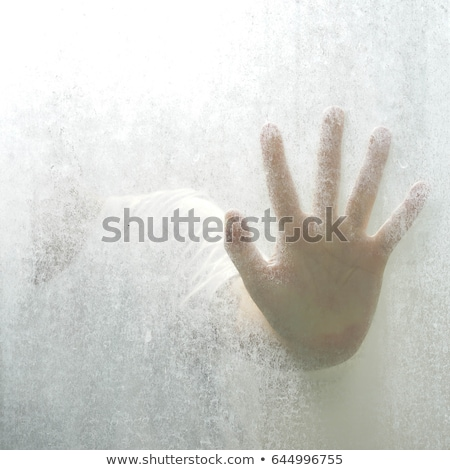 Trapped man, back lit silhouette of hands behind matte glass Stock photo © stevanovicigor