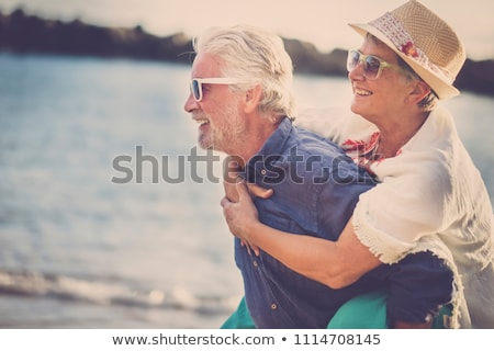 couple having fun together at the beach stock photo © deandrobot