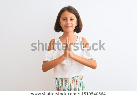 Child begging forgiveness. Stock photo © vystek