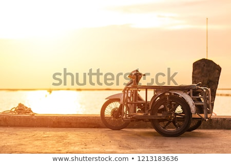 motocicleta · pôr · do · sol · céu · homem · natureza · rua - foto stock © adrenalina