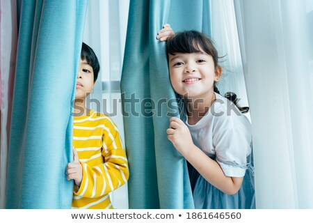 Girl behind the blue curtain Stock photo © bluering