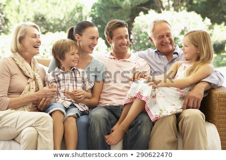 famille · élargie · salon · souriant · fille · homme · enfant - photo stock © monkey_business